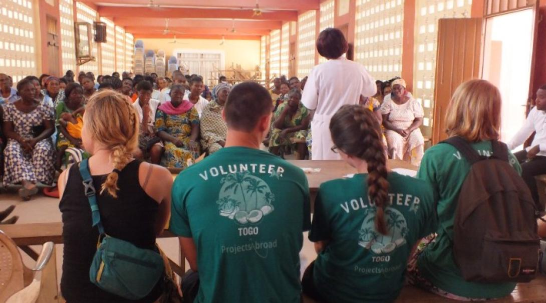 A group of volunteers attend an educational campaign in Togo